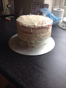 Once the top layer was added I covered the full cake in a thin layer of buttercream then put into the fridge for an hour or so.